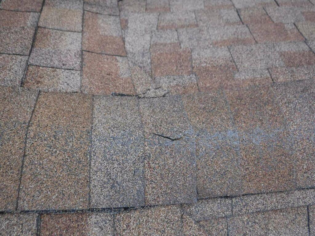 Cracked shingles and granule loss
