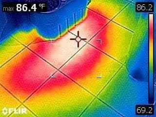 thermal image of a pinhole leak under a concrete slab