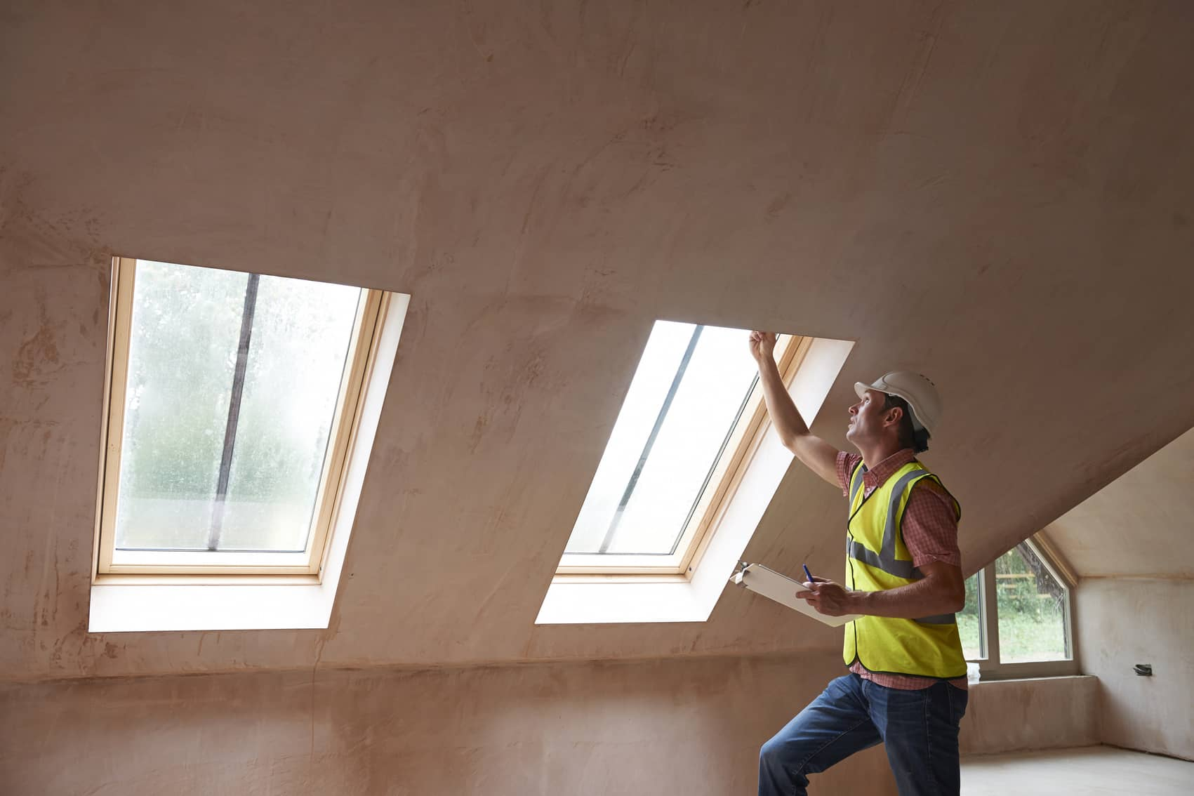Things That Fail A Home Inspection - Home Inspector looking at skylight