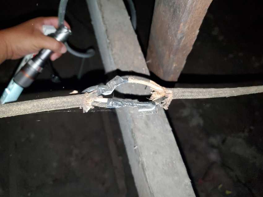 Unprofessional splicing of cloth wiring.